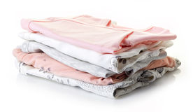 Pile of baby clothes isolated on white Royalty Free Stock Image