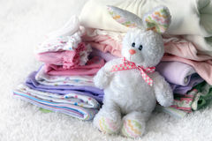 Pile of baby clothes stock photo