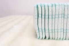 Pile with baby comfort and soft baby diapers on a white background, copy space, lightness royalty free stock images