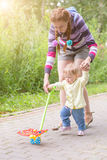 Baby first steps with mom Royalty Free Stock Images