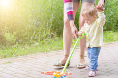 Baby first steps with mom Stock Photos