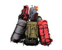 Pile of backpacks. Backpacking concept isolated on white with clipping path Stock Photo