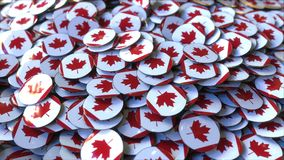 Pile of badges featuring flags of Canada. 3D rendering. Badges featuring flag of Canada Royalty Free Stock Photos