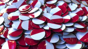 Pile of badges featuring flags of Poland or Monaco. Badges featuring flag of Poland or Monaco stock footage