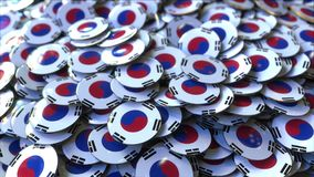 Pile of badges featuring flags of South Korea. 3D rendering. Badges featuring flag of South Korea stock image