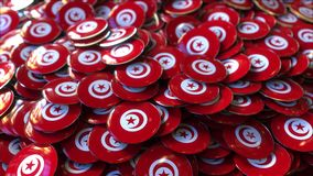 Pile of badges featuring flags of Tunisia. Badges featuring flag of Tunisia stock footage
