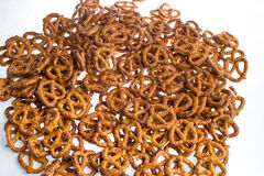 A pile of baked pretzels on white. A pile of baked pretzels on white royalty free stock images