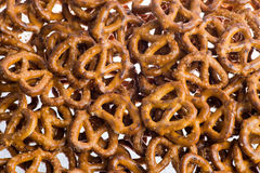 A pile of baked pretzels on white. A huge pile of baked pretzels on white stock photography