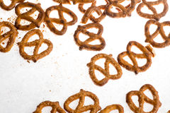 A pile baked pretzels on white. A pile of baked pretzels on white with salt stock images