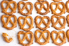 A pile baked pretzels on white. A pile of baked pretzels on white with salt royalty free stock photo