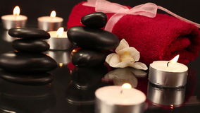 A pile of balanced black spa therapy stones stock video