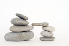 Pile of balanced stones over white Royalty Free Stock Images