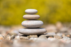 Pile of balancing pebble stones outdoor Stock Image