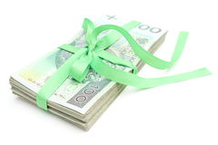 Pile of banknotes with green ribbon,  on white background Royalty Free Stock Photos