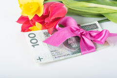 A pile of banknotes related ribbon on gift. Royalty Free Stock Images