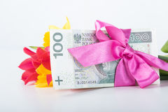 A pile of banknotes related ribbon on gift. Royalty Free Stock Photos