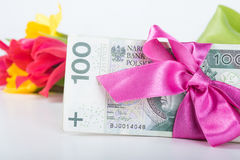 A pile of banknotes related ribbon on gift. Stock Image