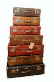 Pile of battered old suitcases. And trunks in poor condition Royalty Free Stock Photo