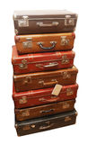 Pile of battered old suitcases. And trunks in poor condition Stock Image