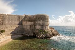 Pile Bay and the wall of Dubrovnik old town in Croatia stock photo