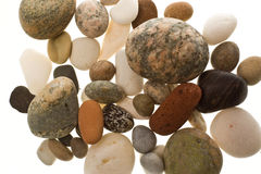 Pile of beach pebbles. Stack of beach rocks isolated on a white background Stock Image