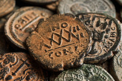 Pile of beautiful ancient copper coins with symbols Royalty Free Stock Image