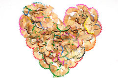 A pile of colorful pencil shavings in a heart shap Stock Images