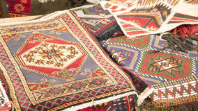 Pile of beautiful handmade carpets on the open market bazaar. Turkish traditional design. Pile of beautiful handmade carpets on the open market bazaar Stock Images