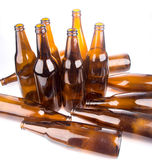Pile of beer bottle on white background Royalty Free Stock Images