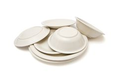 Pile of beige dinner plates, soup plates and sauce Royalty Free Stock Image