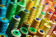Pile of big colorful spools of thread. royalty free stock image