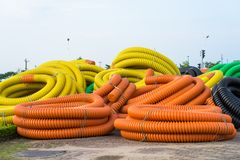 Pile of big industrial plastic corrugated pipes on ground royalty free stock photo
