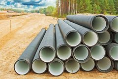 Pile of big water pipes on construction site Royalty Free Stock Photography
