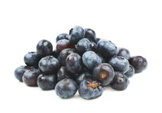 Pile of bilberries isolated. Pile of ripe bilberries isolated over the white background Royalty Free Stock Photos