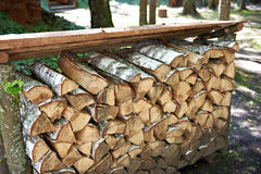 Pile of birch firewood. Outdoors Stock Photo