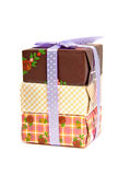 Pile of birthday presents. With purple bow isolated on white background Royalty Free Stock Photo