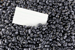 Pile black beans and note paper. Stock Photography