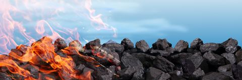 A pile of black coal burns and releases carbon dioxide into the atmosphere between other poisons. Hard coal is one of the greatest treasures of humanity. It is royalty free stock image
