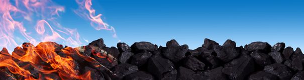 A pile of black coal burns and releases carbon dioxide into the atmosphere between other poisons. Hard coal is one of the greatest treasures of humanity. It is royalty free stock photo