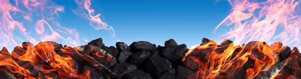 A pile of black coal burns and releases carbon dioxide into the atmosphere between other poisons. Hard coal is one of the greatest treasures of humanity. It is stock image