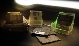 Pile of black floppy disks on dark background with light. Vintage computer attributes Stock Images