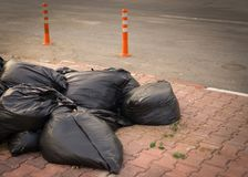 Garbage bags piled outside. stock photo