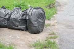 Pile of black garbage bag Stock Photos