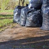 Pile of black garbage bags Royalty Free Stock Photos