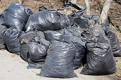 A pile of black garbage plastic bags Stock Photos
