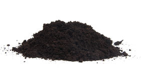 Pile of black garden top soil over white background Royalty Free Stock Photos