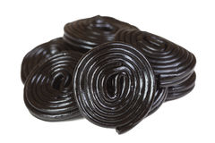 Pile of black licorice spirals Stock Images