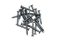 Pile of black nails. On white background Royalty Free Stock Photography