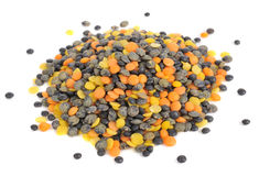Pile of Black, Orange and Yellow Lentils Royalty Free Stock Image