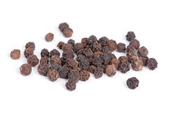 Pile Black pepper  on white background. Royalty Free Stock Image
